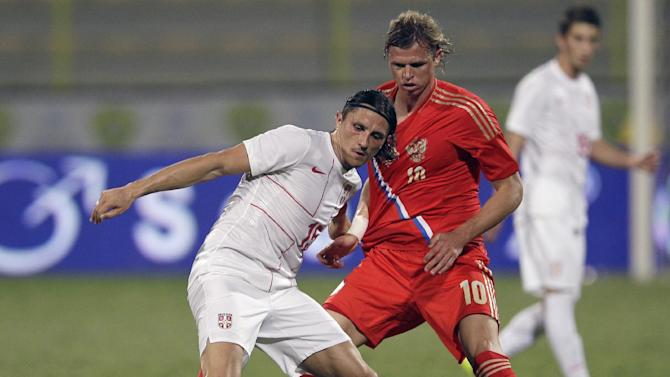 Serbia's Ljubomir, left, fights for the ball with Russia's Dimitri Tarasov during a friendly match Dubai, United Arab Emirates, Friday Nov. 15, 2013