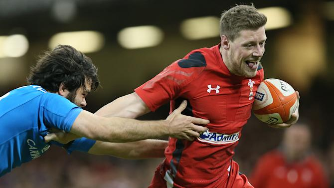 Wales's Rhys Priestland, right, gets away from Italy's Luke McLean during their Six Nations international rugby union match between Wales and Italy at the Millennium stadium in Cardiff, Wales, Saturday, Feb. 1, 2014. (AP Photo/Alastair Grant)