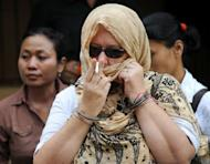 Briton Lindsay June Sandiford (C) leaves for prison after her trial at a court in Denpasar on the Indonesian resort island of Bali on January 22, 2013. The 56-year-old British grandmother was sentenced to death for smuggling cocaine, in a shock verdict after prosecutors recommended 15 years imprisonment