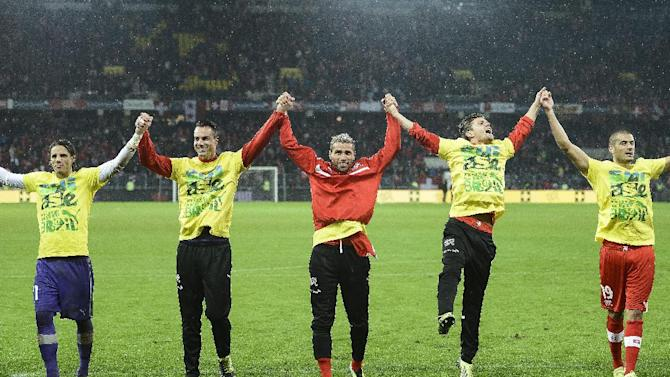 Switzerland's national soccer team, celebrates after winning the FIFA World Cup 2014 group E qualifying soccer match between Switzerland and Slovenia at the Stade de Suisse stadium in Bern, Switzerland, Tuesday, October 15, 2013