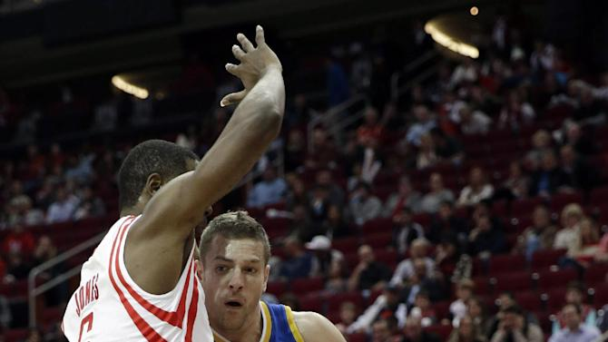 Golden State Warriors' David Lee (10) drives into Houston Rockets' Terrence Jones (6) during the first quarter of an NBA basketball game Friday, Dec. 6, 2013, in Houston