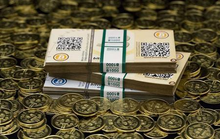 "Some of Bitcoin enthusiast Mike Caldwell's coins and paper vouchers, often called ""paper wallets"", are pictured at his office in this photo illustration in Sandy, Utah, January 31, 2014. REUTERS/Jim Urquhart"