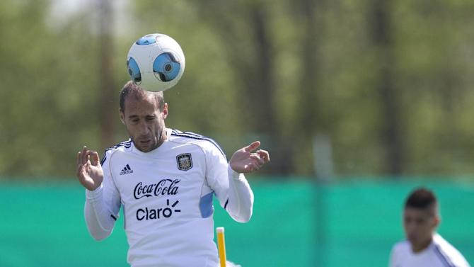 Argentian's Pablo Zabaleta heads the ball during a team training session ahead a Brazil 2014 World Cup qualifying soccer match against Peru in Buenos Aires, Argentina, Tuesday, Oct. 8, 2013