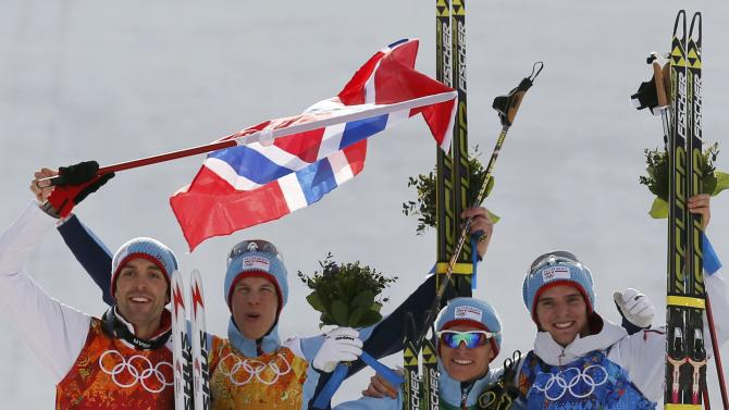 Norway's team members take part in the flower ceremony for the Nordic Combined team Gundersen event of the Sochi 2014 Winter Olympic Games