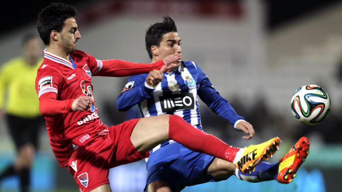 Gil Vicente's Luis Martins fights for the ball with Porto's Josue during their Portuguese Premier League soccer match in Barcelos