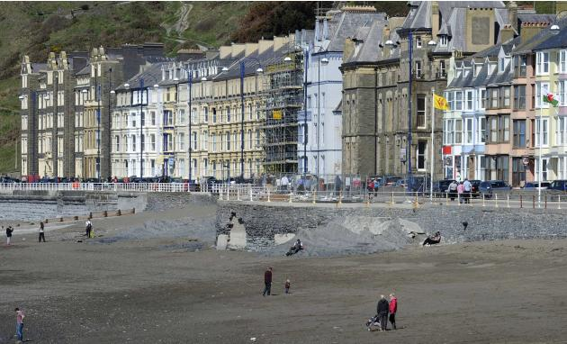 People mill around the promenade, which has been repaired in time for the Easter Bank Holiday in Aberystwyth