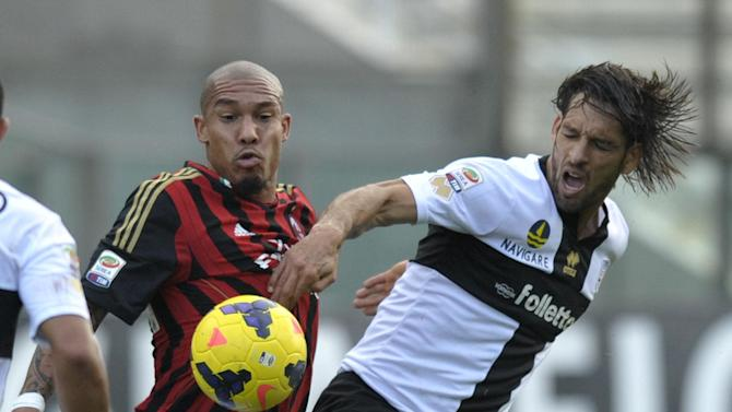Parma's Carvalho Amauri, right, vies for the ball with AC Milan's Nigel De Jong, of the Netherlands, during their Serie A soccer match at Parma's Tardini stadium, Italy, Sunday, Oct. 27, 2013