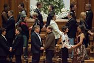 Couples exchange vows during a mass wedding for 25 same-sex partners at Seattle First Baptist Church on December 9, in Seattle, Washington. Hundreds of same-sex couples flocked to get married in the northwest state of Washington, the first day possible after the state approved gay marriage in a referendum in November.