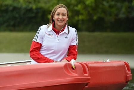 British Olympic champion heptathlete Jessica Ennis-Hill arrives in a boat at the Serpentine lake at Hyde Park in London
