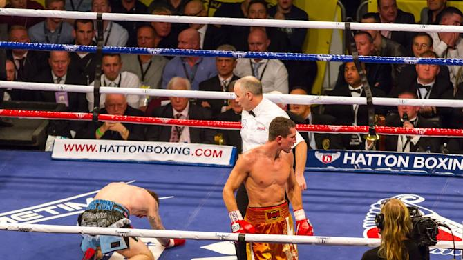 Ricky Hatton on his knees 10 rounds later  (photo: Neill Hamersley)