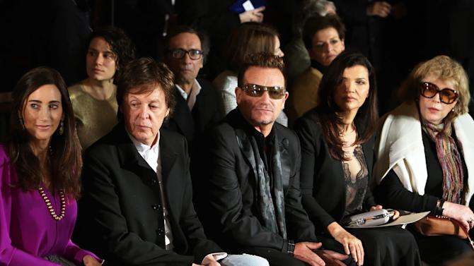 From left, Nancy Shevell, Sir Paul McCartney, Bono, Ali Hewson and Marianne Faithfull watch fashion designer Stella McCartney's Fall/Winter 2013-2014 ready to wear collection, in Paris, Monday, March, 4, 2013. (AP Photo/Thibault Camus)