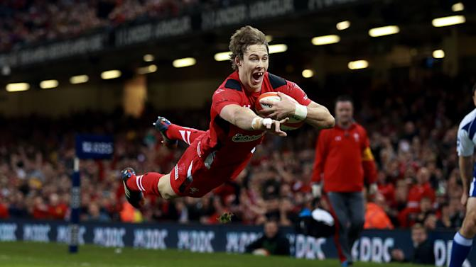 Wales' Liam Williams scores their first try during the Six Nations rugby union match between Wales and Scotland at the Millennium Stadium, Cardiff, Wales, Saturday, March 15, 2014. (AP Photo/David Davies, PA Wire) UNITED KINGDOM OUT - NO SALES - NO ARCHIVES
