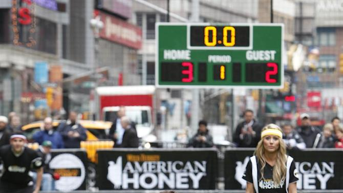 IMAGE DISTRIBUTED FOR AMERICAN HONEY - Eleven time Olympic medalist and TV star Ryan Lochte throws the first pitch at American Honey Bar-sity Athletics kickball game in Times Square, on Tuesday, April, 23, 2013 in New York City, New York. (Photo by Mark Von Holden/Invision for American Honey/AP Images)