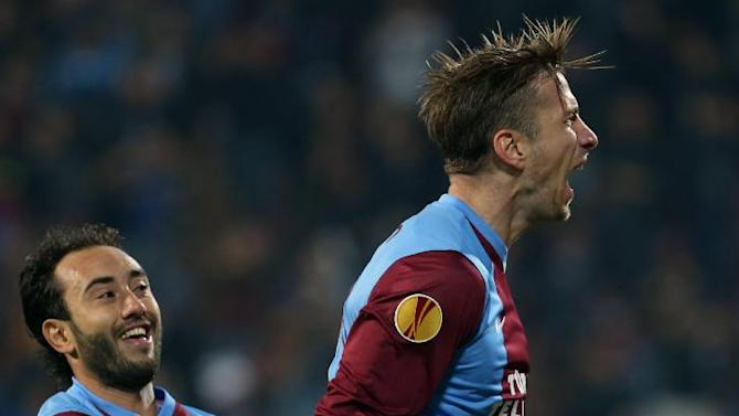 Trabzonspor's Janko, right, celebrates his goal with teammate Olcab Adin during their Europa League Group J soccer match against Legia in Trabzon, Turkey, Thursday, Oct. 24, 2013. (AP Photo)