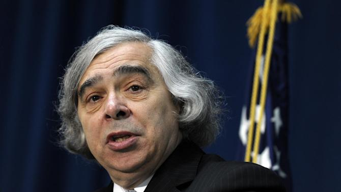 FILE - In this May 21, 2013 file photo, Energy Secretary Ernest Moniz speaks after being sworn in as Energy Secretary, at the Energy Department in Washington. Moniz says coal will continue to play a role in meeting America's energy needs even as the Obama administration seeks to reduce carbon emissions and combat global warming. In an interview with The Associated Press, Moniz refuted claims by Republicans and even some coal-state Democrats that the president's climate plan would cripple the coal industry. (AP Photo/Susan Walsh, File)