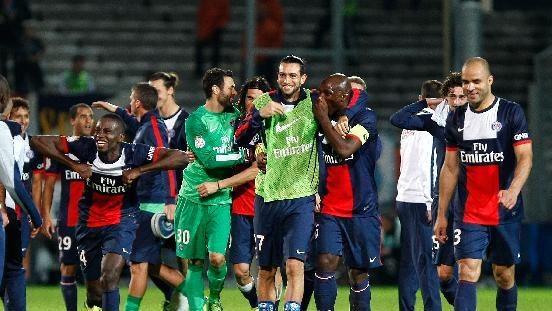 Paris Saint-Germain players celebrate after defeating Marseille, during their League One soccer match, at the Velodrome Stadium, in Marseille, southern France, Sunday, Oct. 6, 2013