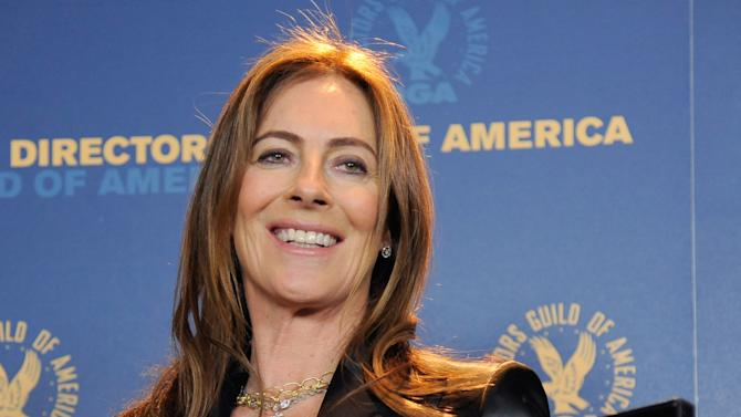 "Kathryn Bigelow poses backstage with her feature film nomination plaque for ""Zero Dark Thirty"" at the 65th Annual Directors Guild of America Awards at the Ray Dolby Ballroom on Saturday, Feb. 2, 2013, in Los Angeles. (Photo by Chris Pizzello/Invision/AP)"