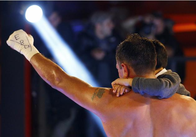 Italy's Michele Di Rocco celebrates with his son Francesco after winning against Denmark's Kasper Bruun in  their European super lightweight boxing title fight in Milan