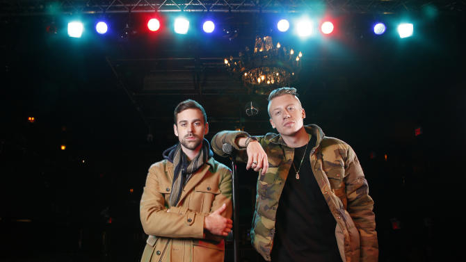 FILE - In this Tuesday, Nov. 20, 2012 file photo, American musician Ben Haggerty, better known by his stage name Macklemore, right, and his producer Ryan Lewis pose for a portrait, at Irving Plaza in New York. (Photo by Carlo Allegri/Invision/AP, File)