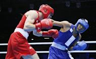 Thomas Stalker of Great Britain (in red) defends against Munkh-Erdene Uranchimeg of Mongolia (in blue) during the Light Welterweight boxing quarterfinals of the 2012 London Olympic Games at the ExCel Arena in London. Uranchimeg advanced to the semi-finals on a close 23-22 points decision