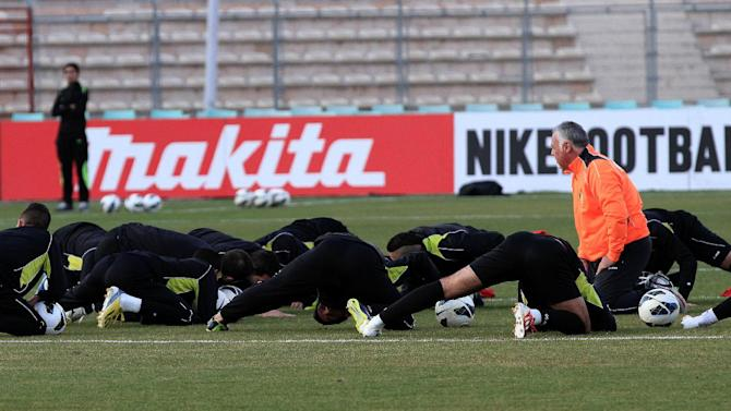 CORRECTS NAME AND TITLE OF COACH- Manuel Barrionuevo, a Brazilian Fitness Coach of Jordan's national soccer team, watches his players during a training session at Amman International stadium in Amman, Jordan, Tuesday, Nov. 12, 2013, before their World Cup qualifying soccer match against Uruguay on Wednesday