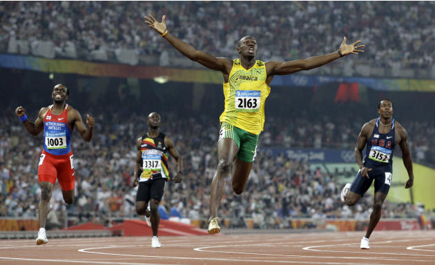 FILE - In this Aug. 20, 2008 file photo made by Associated Press photographer Anja Niedringhaus, Jamaica's Usain Bolt crosses the finish line to win the gold in the men's 200-meter final at th