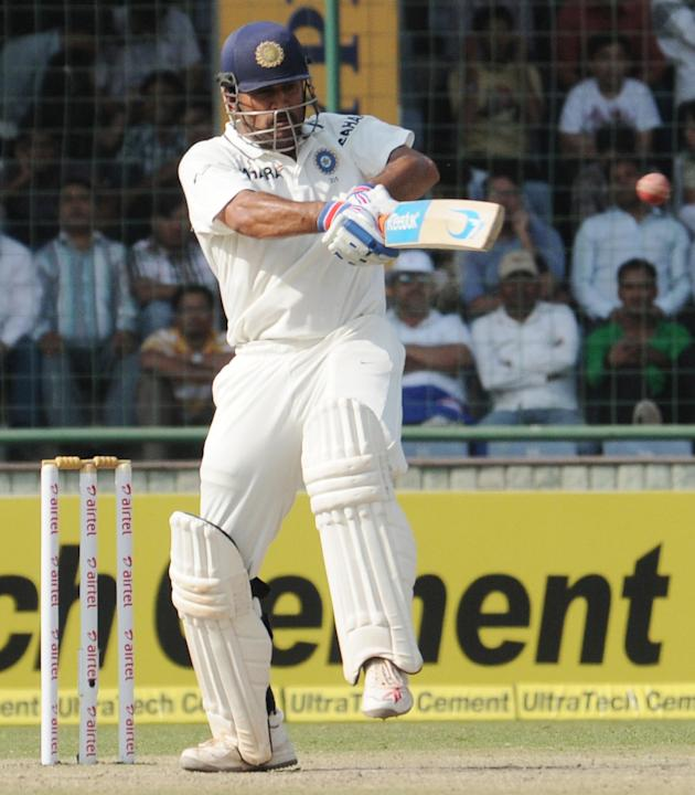 Indian skipper MS Dhoni plays a pull shot while batting against Australia during the 4th test match of Border-Gavaskar Trophy, at Feroz Shah Kotla Stadium in Delhi on March 23, 2013. P D Photo by P S