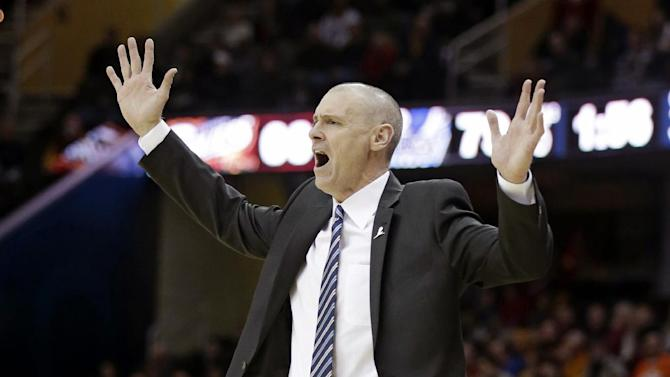 Dallas Mavericks head coach Rick Carlisle yells on the sideline during the fourth quarter of an NBA basketball game against the Cleveland Cavaliers Monday, Jan. 20, 2014, in Cleveland. Dallas defeated Cleveland 102-97