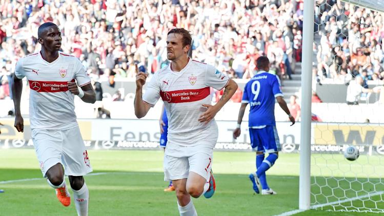 Stuttgart's goal scorer Martin Harnik, right, and Antonio Ruediger celebrate after scoring during the German Bundesliga soccer match between VfB Stuttgart and FC Schalke 04 at the Mercedes-Benz Arena in Stuttgart, Germany, April 20,2014