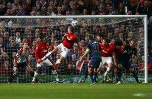 Manchester United's Vidic scores a goal against Bayern Munich during their Champions League quarter-final first leg soccer match at Old Trafford in Manchester