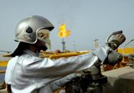 This file photo shows technician working on Iranian offshore oil platform in the Gulf waters, in 2004. S.Korea said on Tuesday it would be forced to halt imports of Iranian oil from July because of European Union sanctions aimed at pressuring Tehran to abandon its suspected nuclear weapons programme