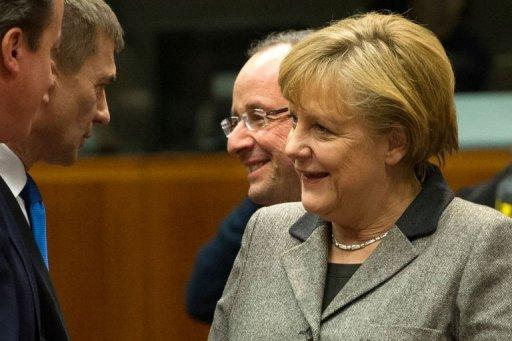 German Chancellor Angela Merkel (R) and French President Francois Hollande (2R) are pictured during a roundtable meeting at the EU Headquarters on December 13, 2012 in Brussels.