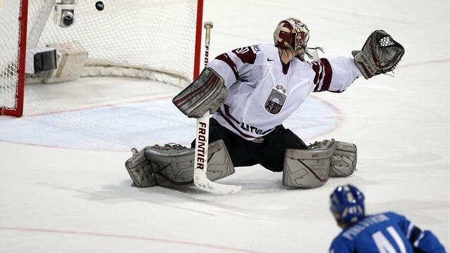 Ice Hockey - Finns edge Latvia to top group, US lose to Slovakia