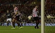 Manchester United's Adnan Januzaj (L) shoots to score his second goal against Sunderland during their English Premier League soccer match at The Stadium of Light in Sunderland, northern England, October 5, 2013. REUTERS/Nigel Roddis