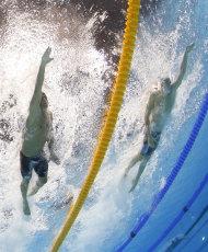 France's Yannick Agnel, right, and United States' Ryan Lochte, compete in the men's 4x100-meter freestyle relay final at the Aquatics Centre in the Olympic Park during the 2012 Summer Olympics in London, Sunday, July 29, 2012. (AP Photo/David J. Phillip)