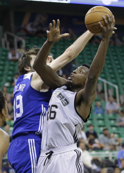 San Antonio Spurs Cady Lalanne shoots as Philadelphia 76ers Fukan Aldemir defends during the first half of an NBA summer league basketball game Monday, July 6, 2015, in Salt Lake City.  (AP Photo/Rick