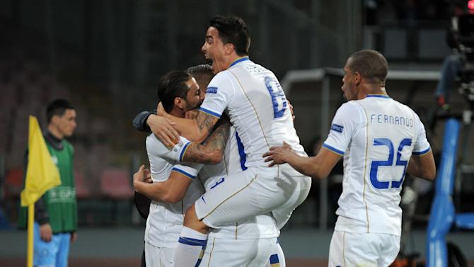 Porto's Nabil Ghilas, hidden by teammates, is cheered after scoring during an Europa League, round of 16 return-leg soccer match against Napoli at the Naples San Paolo stadium, Italy, Thursday, March 20, 2014