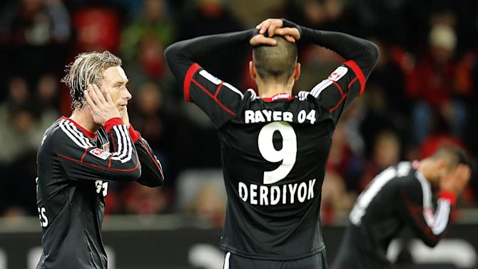 Leverkusen players react to a missed chance  during the German first division Bundesliga soccer match between Bayer Leverkusen and Eintracht Frankfurt in Leverkusen, Germany, Sunday, Dec. 15, 2013