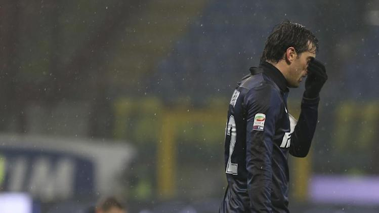 Inter Milan Argentine forward Diego Milito leaves the field of play at the end of a Serie A soccer match between Inter Milan and Chievo, at the San Siro stadium in Milan, Italy, Monday, Jan. 13, 2014. The match ended in a 1-1 draw