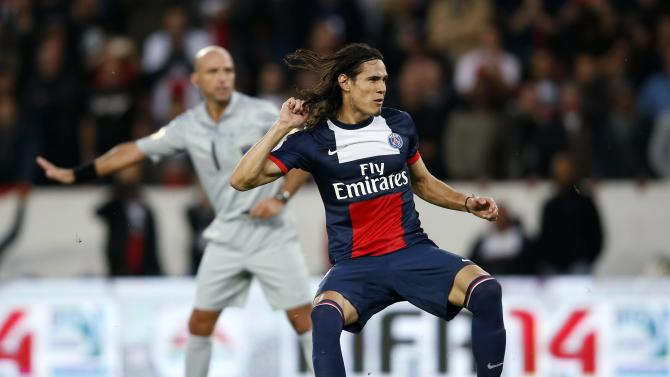 Paris St Germain's Cavani celebrates after scoring a penalty for the team during their French Ligue 1 soccer match against Bastia in Paris