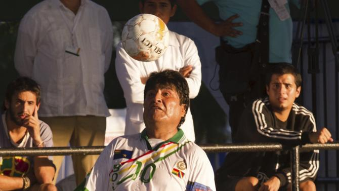 Handout of Bolivia's President Evo Morales controlling the ball during a soccer match during the Community of Latin American and Caribbean States (CELAC) summit in La Habana