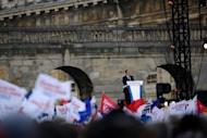 French Socialist Party candidate Francois Hollande gives a speech during a campaign meeting on April 15 in Paris. Hollande's presidential bid has been hit by the intrusion of disgraced IMF chief Dominique Strauss-Kahn into the campaign