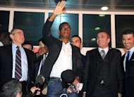 Galatasaray's new forward Didier Drogba (C) waves to supporters as he arrives at the Ataturk airport in Istanbul, on February 8, 2013