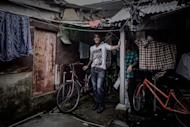 This picture taken on June 11, 2013 shows Bangladeshi refugee Nazmul Huda at a housing compound for asylum seekers in the rural Ping Che district of Hong Kong -- near the border with mainland China. Hong Kong may be one of Asia's wealthiest hubs, but the picture is very different for hundreds of asylum seekers forced into slum-like conditions as they scrape a living in the city