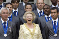 FILE- In this Tuesday, July 13, 2010 file photo, The Netherlands' World Cup team poses with Queen Beatrix, center, at Noordeinde Palace in The Hague, Netherlands, during a day of celebrations for the tournament runners-up. The Dutch Royal House says Queen Beatrix will deliver a nationally televised speech, on Monday, Jan. 28, 2013, and speculation is growing that the popular monarch will announce she is to abdicate. Beatrix, who turns 75 on Thursday, has ruled this nation of 16 million for more than 32 years and would be succeeded by her eldest son, Crown Prince Willem-Alexander. (AP Photo/Rob Keeris, File)