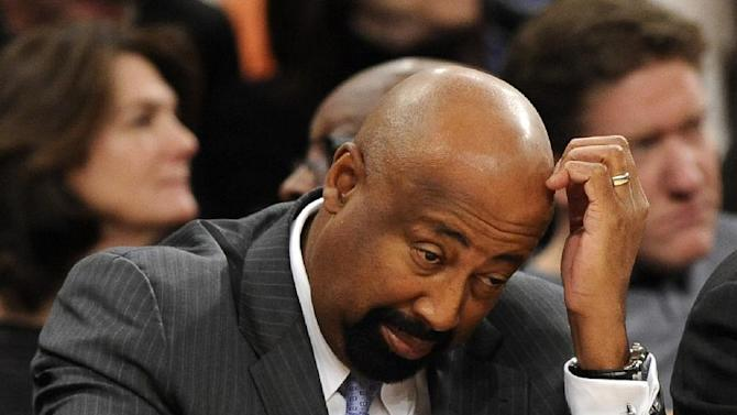 New York Knicks' head coach Mike Woodson reacts as his team falls behind the Boston Celtics during the second half of an NBA basketball game on Sunday, Dec. 8, 2013, in New York. The Celtics won 114-73