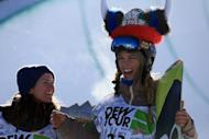 Torah Bright takes the podium after winning the women's snowboard superpipe final at the Dew Tour iON Mountain Championships on December 14, 2013 in Breckenridge, Colorado