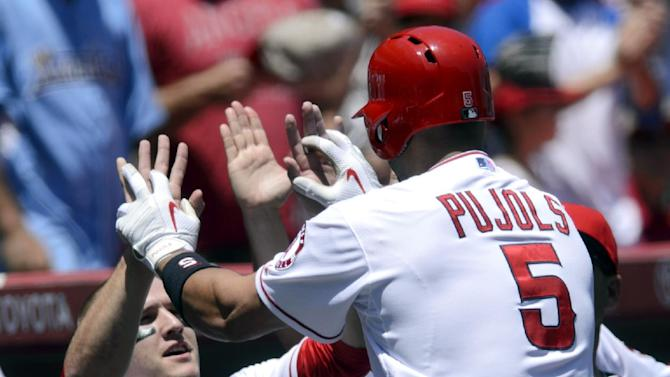 Pujols hits 2 homers to help Angels beat Rays 6-2