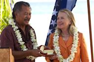 US Secretary of State Hillary Clinton (R) receives gifts from Cook Islands PM Henry Puna during the Pacific Islands Forum in Rarotonga, Cook Islands, on August 31. Clinton was heading Sunday from the Cook Islands to Indonesia before she meets China's leaders in Beijing