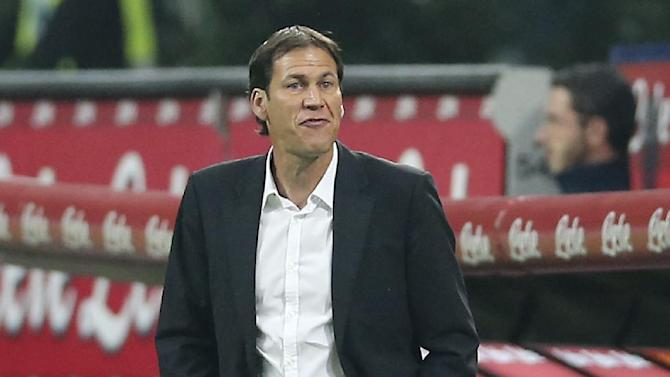 AS Roma coach Rudi Garcia, of France, gestures during the Serie A soccer match between Inter Milan and Roma at the San Siro stadium in Milan, Italy, Saturday, Oct. 5, 2013